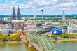 Leinwandbild Motiv Aerial view of the cathedral in Cologne and Hohenzollern bridge over Rhein, Germany