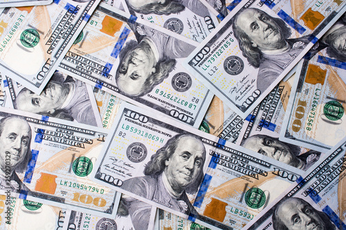 American 100 dollar banknotes placed on white background