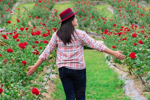 Woman walking in the rose garden happily © arthit