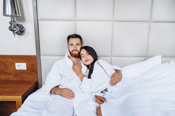 Picture showing happy couple resting in hotel room