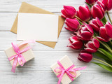 Gift boxes and tulips bouquet