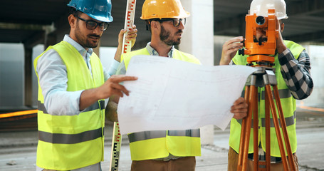 Architect consult engineer on modern construction site