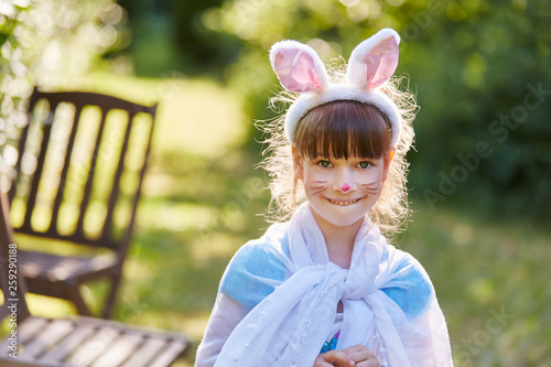 Girl dressed like bunny © Robert Kneschke