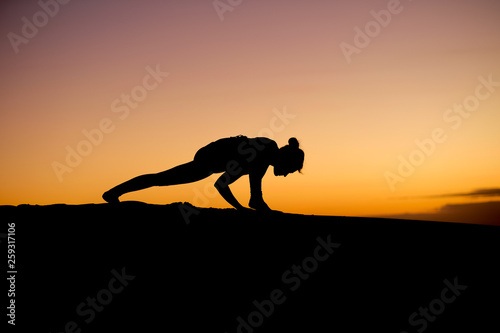 fototapeta na ścianę Fantastic moves from a yoga instructor make for fantastic silhouettes