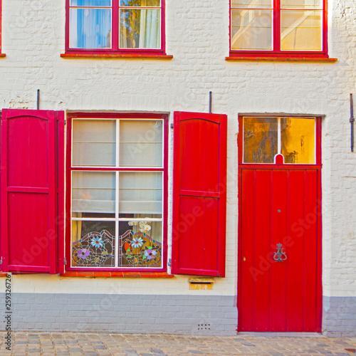 fototapeta na ścianę The houses of Brugge, - red windows and doors. Belgium