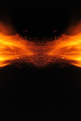 Abstraction, burning fire with sparks. Mystical prototype with patterns for the background. Horizontal reflection.