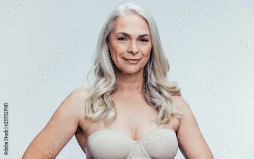 Leinwandbild Motiv Confident senior woman in lingerie