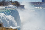 View of the American Falls in Niagara Falls in winter with frozen ice and snow in the Niagara River