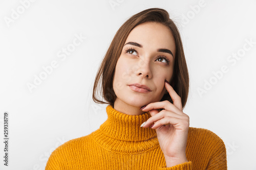 Leinwandbild Motiv Attractive young woman standing isolated
