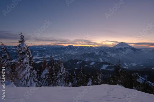 canvas print picture Winterlandschaft im Sonnenuntergang