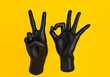Number 20 black hand fingers gestures isolated on yellow, 3d rendering