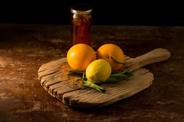 Lemon and honey on table