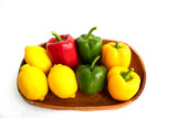 colerful bell peppers and lemon on white background