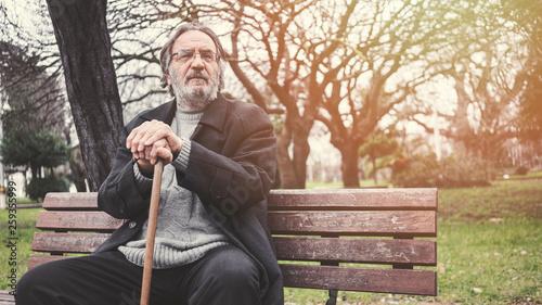 Leinwandbild Motiv Old man in the park