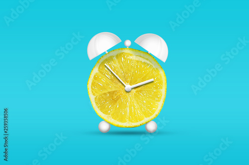 Lemon in the form of an alarm clock. Healthy eating concept. Diets Fresh natural fruits. - 259358506
