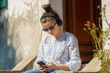 young teenager girl with sunglasses listening music outdoor