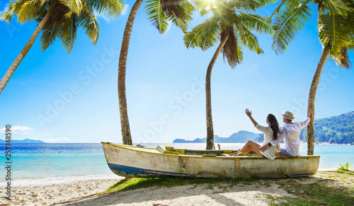 Happy Couple Relaxing on the Ocean. Seychelles island