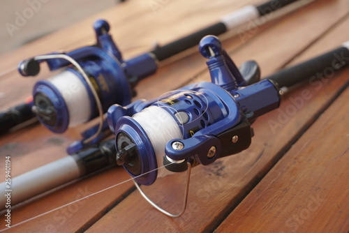fishing tackle on a wooden table  © taraskobryn