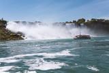 A tour boat passing the American Falls at Niagara Falls, Canada