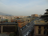 Genova, Italy - 04/02/2019: An amazing caption of the city of Genova from the hills in winter days, with a great grey sky, some tall skyscrapers and beautiful old buildings