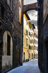 Street with arch in the historic Old Town of Florence, Tuscany, Italy