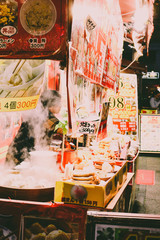 Close up of a food stall at a night market in Chinatown, Kobe, Japan