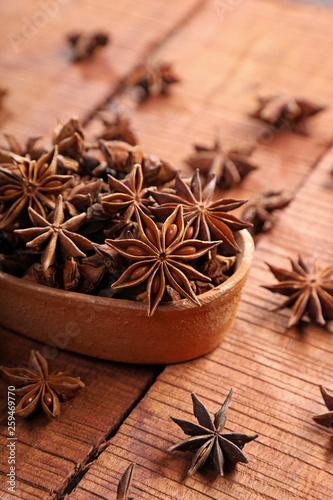 Organic Indian Spice / Herb Star Anise in a Brown Bowl © Akhilesh Sharma