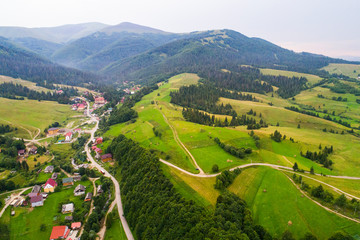 Forests, meadows  and hills of the Carpathian mountains taken with drone, Ukraine