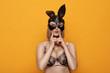 Leinwandbild Motiv Sexy blonde girl with leather bunny ears