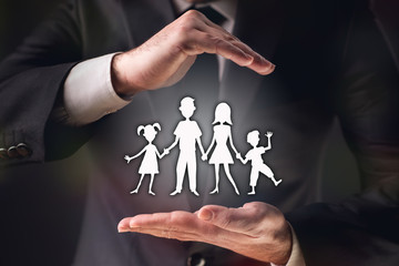 Concept For Family Insurance with Businessman on Dark Background