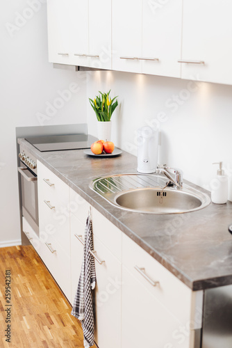 Fitted white kitchen with appliances and sink