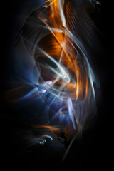 The abstract image painted by moving light and moving objects on a black background. Color abstraction.