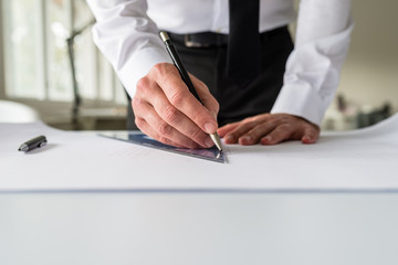 Architect drawing a draft on a paper