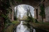 brick bridge in the forest
