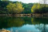 Fototapeta Fototapety na ścianę - reflection of two trees in a lake, la arboleda, basque country © Ander