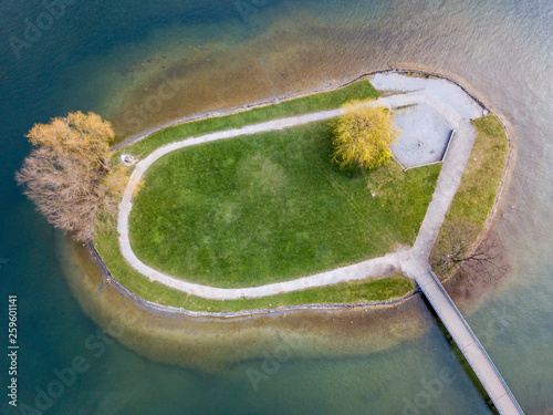 Aerial view of small island near coast on a lake in Switzerland