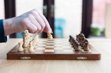 chess board moves on wooden set board