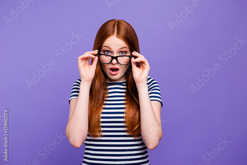 Leinwandbild Motiv Portrait of her she nice-looking attractive charming cute lovely winsome confused youngster lady looking putting glasses off isolated over bright vivid shine violet background