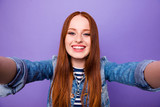 Self-portrait of her she nice attractive charming cute winsome lovely cheerful cheery straight-haired lady youngster isolated over bright vivid shine violet background