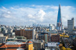 Bright panoramic view of the London skyline from the South Bank neighborhood with a view of the modern skyscrapers of the City financial district on a bright sunny autumn afternoon - 259691336