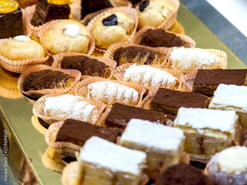 Small tasty cakes on a show-window in cafe © Elena Belyaeva