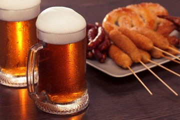 Beer glass alcohol drink with food sausage, grilled picnic.