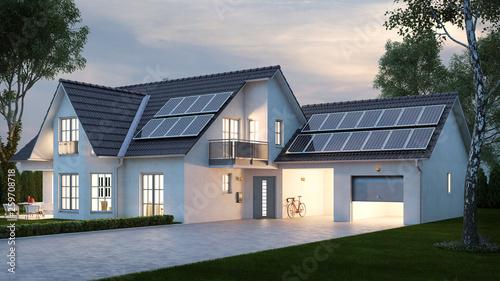 Leinwandbild Motiv Haus mit Beleuchtung abends vor Himmel