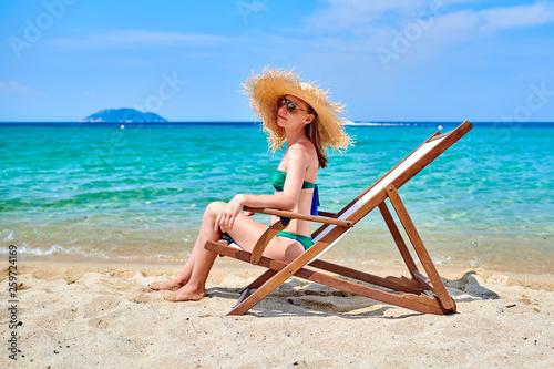 Leinwandbild Motiv Woman in bikini on beach