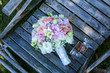 Beautiful bouquet of flowers on wooden chair