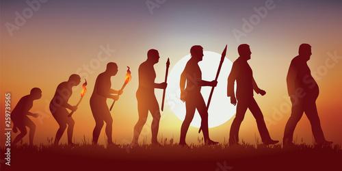 Concept de l'obésité et de la mauvaise alimentation avec le symbole de Darwin montrant l'évolution de l'homme primitif vers l'homme moderne, aboutissant à un homme en surpoids qui marche péniblement. - 259739565