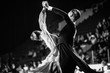 Leinwandbild Motiv couple of dancers man and woman dancing black-and-white photo