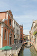 Narrow water channel in Venice Italy