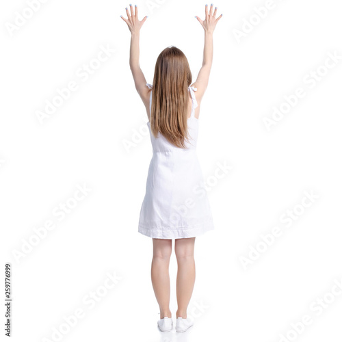 Leinwandbild Motiv Woman in white dress standing hands up on white background isolation, back view