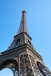 Eiffel Tower in Paris in a sunny day, low angle view and clear blue sky